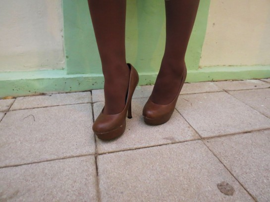 Brown pumps and tights