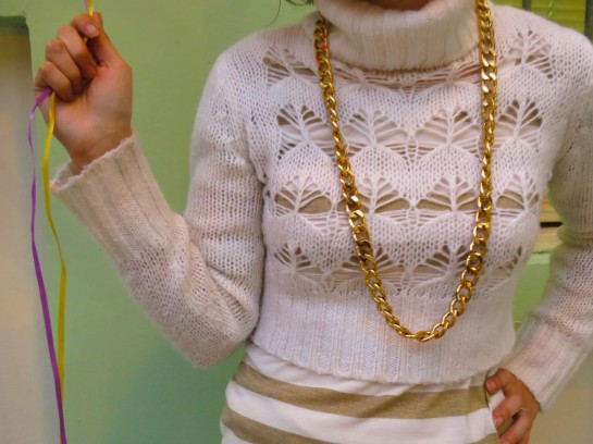 Knit sweater and gold chain